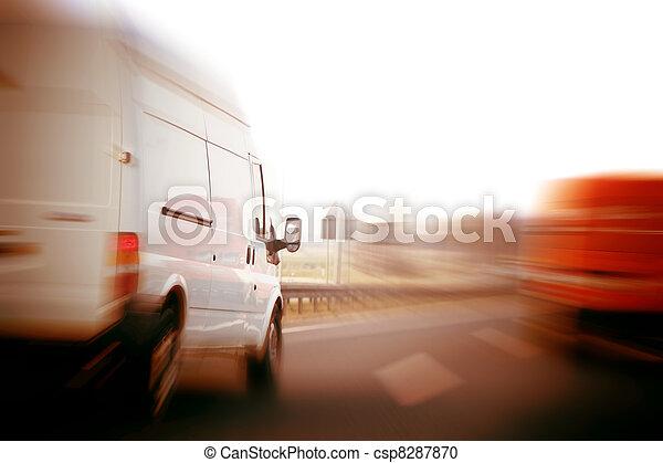 Trucks, delivery vans on freeway - csp8287870