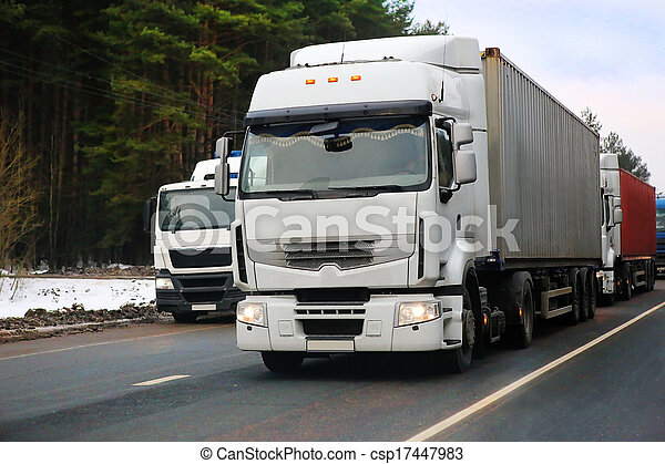 trucks go on the highway in the winter - csp17447983