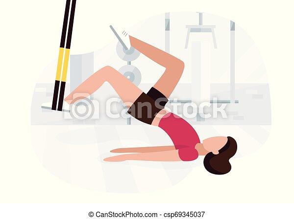 Una mujer en forma trabajando en TRX haciendo ejercicios de glúteos de peso corporal con ejercicio de cadera de puente en el culo. Entrenamiento de entrenamiento - csp69345037