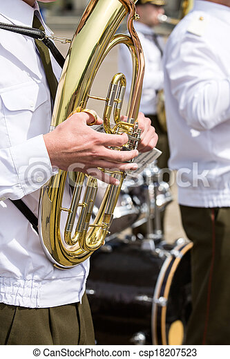 Tuba player in military band - csp18207523