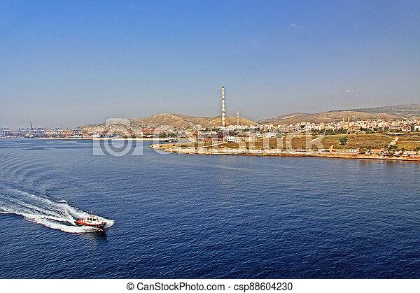 Tug Boat heading towards the Port of Piraeus, Athens, Greece - csp88604230