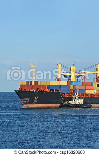 Tugboat assisting container cargo ship - csp16320660