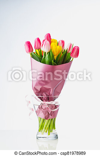 tulip flowers bouquet in a glass vase, isolated on white - csp81978989
