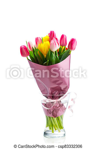 tulip flowers bouquet in a glass vase, isolated on white - csp83332306