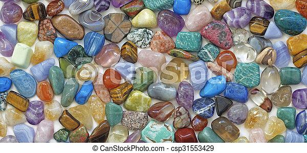 Tumbled crystal stones background - csp31553429
