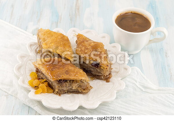 Turkish baklava dessert and coffee on a plate - csp42123110
