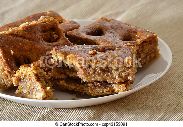 Turkish baklava with walnuts on a white plate - csp43153091