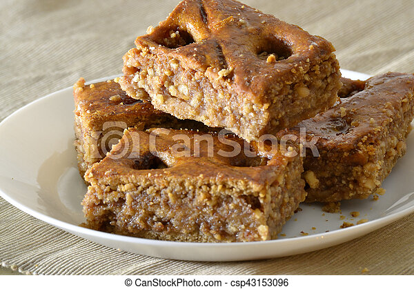Turkish baklava with walnuts on a white plate - csp43153096