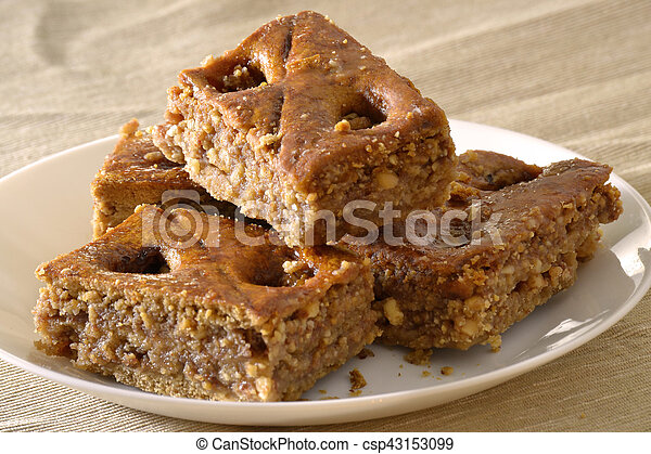 Turkish baklava with walnuts on a white plate - csp43153099