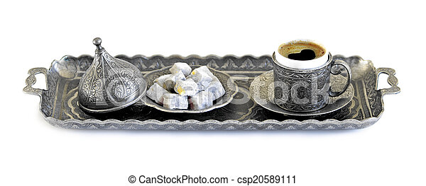 Turkish coffee and turkish delight with old traditional embossed metal cup and tray - csp20589111