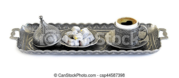 Turkish coffee and turkish delight with old traditional embossed metal cup and tray - csp44587398