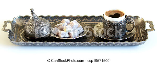 Turkish coffee and turkish delight with old traditional embossed metal cup and tray - csp19571500