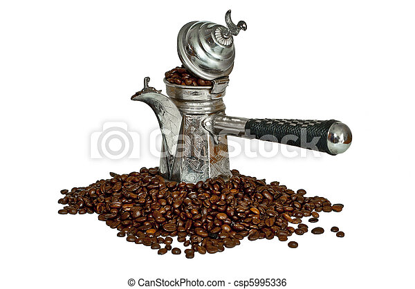 Turkish coffee pot and coffee beans - csp5995336