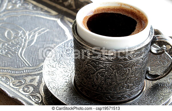 Turkish coffee with old traditional embossed metal cup and tray - csp19571513