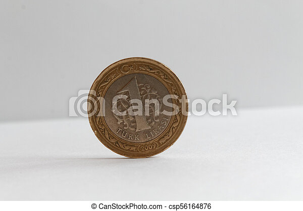 Turkish coin denomination is 1 lira lie on isolated white background - csp56164876
