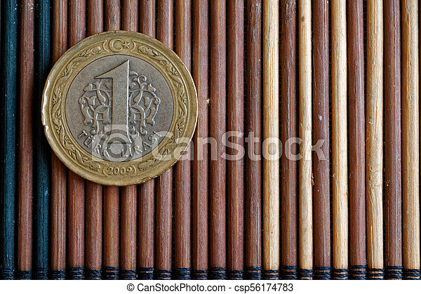 Turkish coin denomination is 1 lira lie on wooden bamboo table, good for background or postcard - csp56174783
