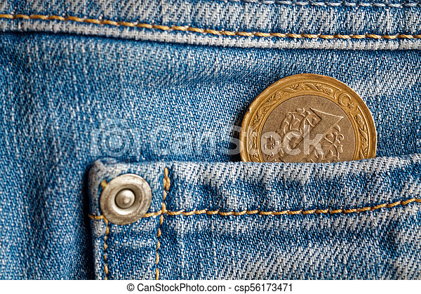 Turkish coin with a denomination of 1 lira in the pocket of light blue denim jeans - csp56173471