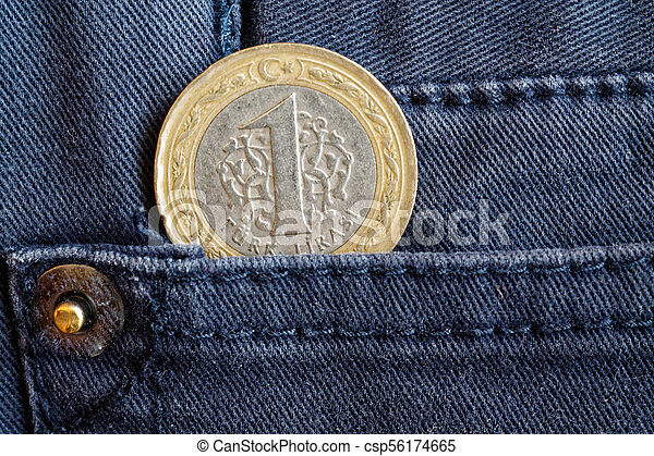 Turkish coin with a denomination of 1 lira in the pocket of gray denim jeans - csp56174665