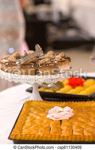 Turkish Dessert Baklava with walnuts on a table - csp61130409