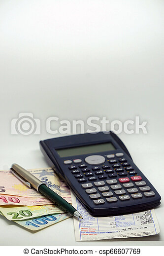 Turkish lira banknotes calculator bills and tax calculations on isolated background - csp66607769