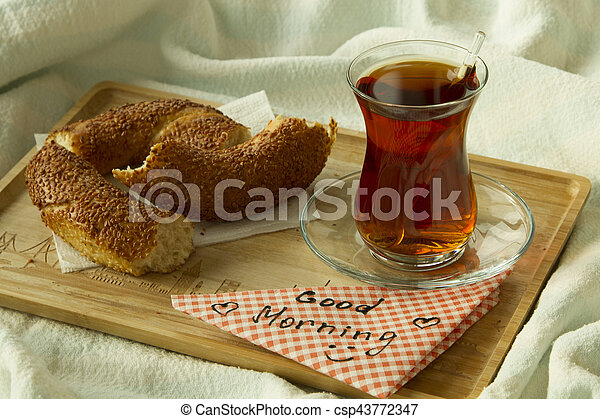 Turkish Tea In Traditional Glass With Bagel On The Tray With Words Good Morning Written On Napkin