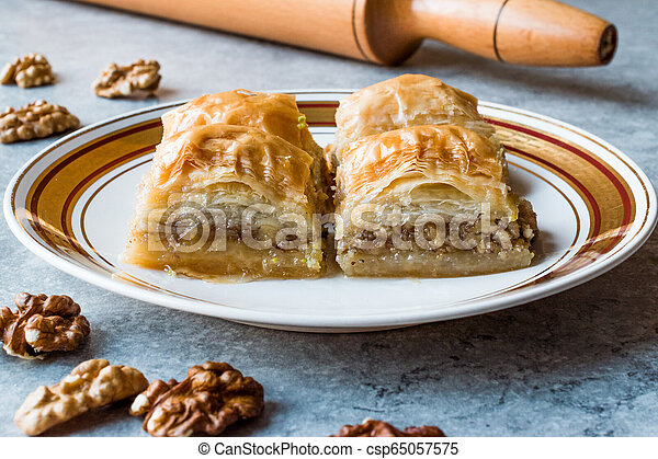 Turkish Traditional Dessert Baklava with Walnuts. - csp65057575