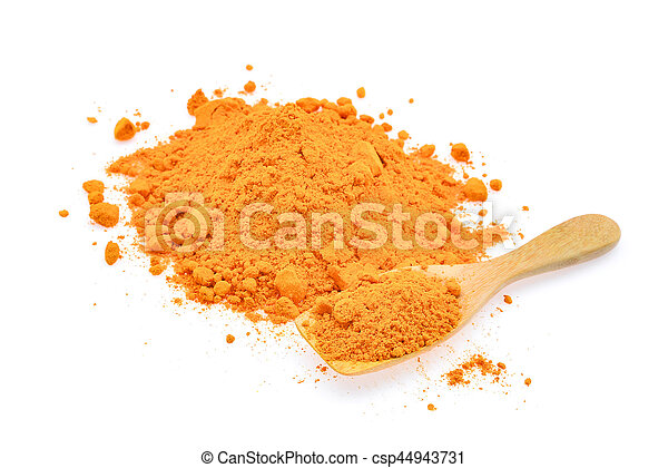 turmeric powder in wooden spoon isolated on white background - csp44943731