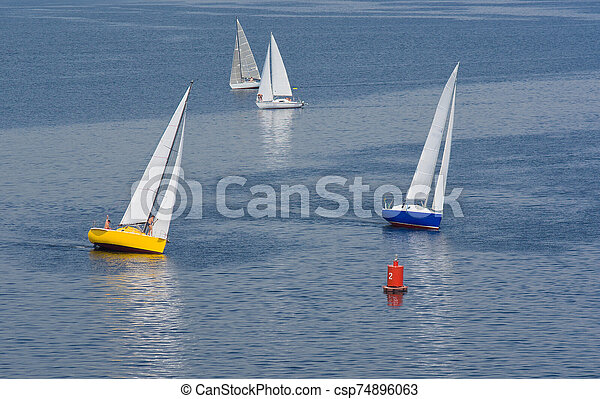 Turn in yachting race on a summer river - csp74896063