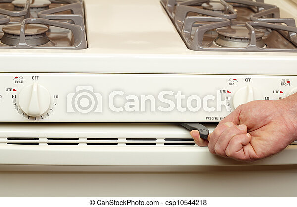 Turning on Self Cleaning Stove - csp10544218