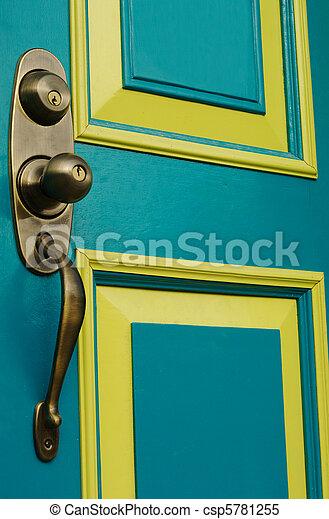 Turquoise colored door with metal doorknob and handle  - csp5781255