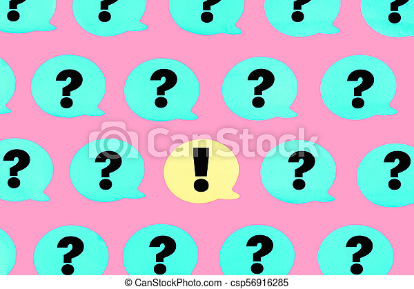 Turquoise stickers with question marks on a pink background in the center is a yellow