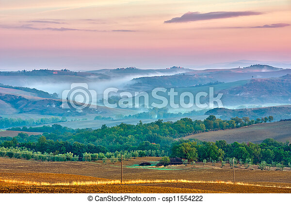 Tuscany landscape at sunrise - csp11554222