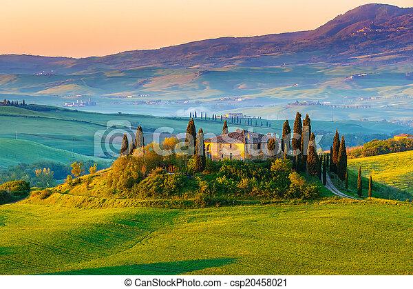 Tuscany landscape at sunrise - csp20458021