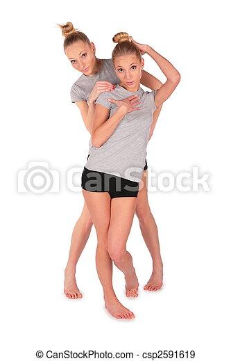 Twin sport girls posing - csp2591619