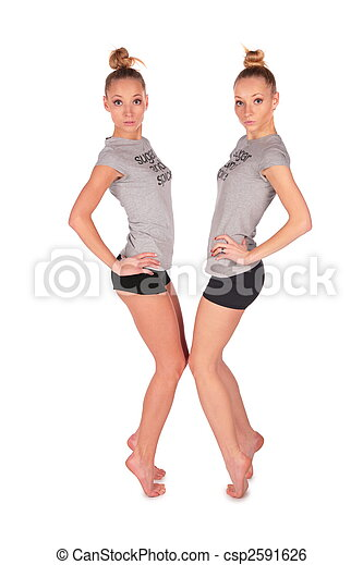 Twin sport girls stands on tiptoe face-to-face - csp2591626