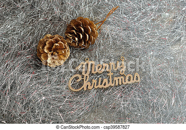 Two acorns with merry Christmas isolated on silver tinsel - csp39587827