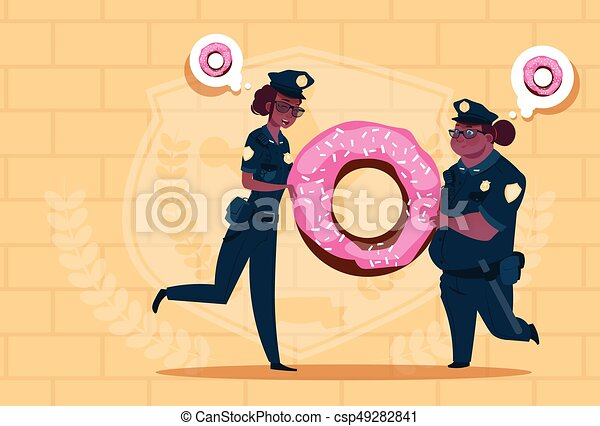 Two African American Police Women Holding Donut Wearing Uniform Female Guards On Blue Bricks Background - csp49282841