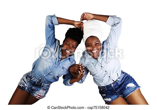 Two African American Women Wear Head Scarfs Reclining - csp75158042