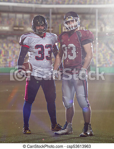 Two American football players standing  on the field - csp53613963