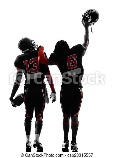 two american football players walking rear view silhouette - csp23315557
