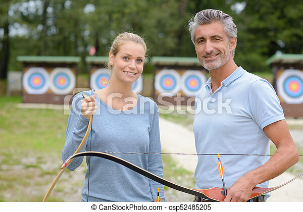 two archers at the shooting range - csp52485205