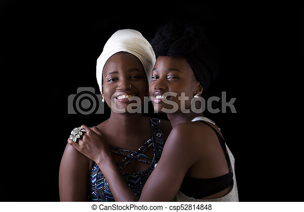 Two Attractive Smiling African American Sisters Portrait - csp52814848