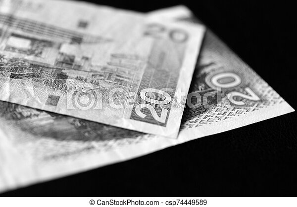 Two banknotes of twenty Hong Kong dollars on a dark background close-up. Black and white - csp74449589