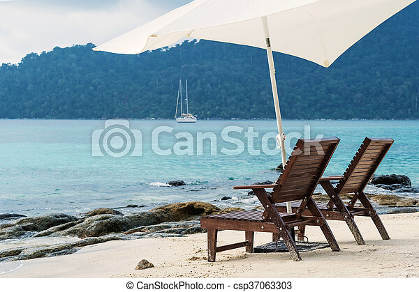 Two beach chairs on the beach - csp37063303
