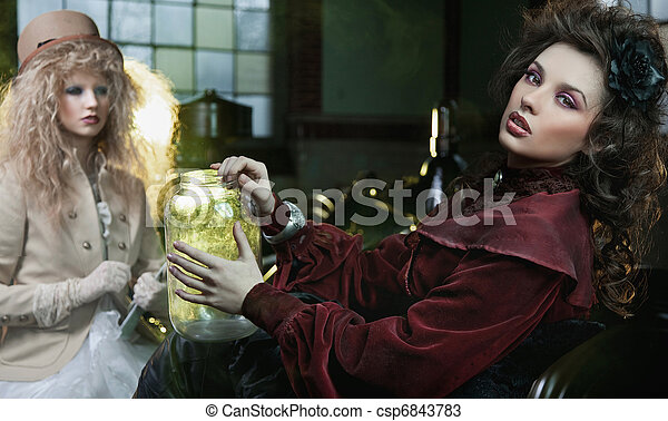 Two beautiful lady in old laboratory - csp6843783