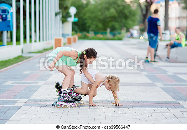 two beautiful little sisters in a roller skates - csp39566447