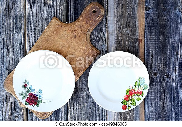 Two beautiful plates on wooden background - csp49846065