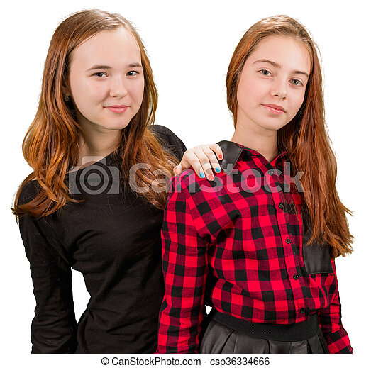 Two beautiful teen girls in red and black clothes - csp36334666
