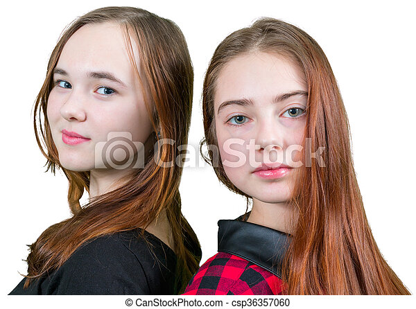 Two beautiful teen girls in red and black clothes - csp36357060