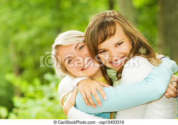 Two beautiful young women outdoors - csp10403316